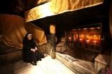 Nun Prays in the Birthplace of Jesus