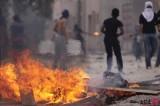Bahraini Protesters Face Riot Police