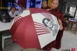 Buying Umbrella For Suu Kyi?