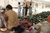 A road vendor's sleeping infant