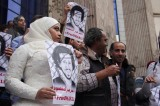 Wife of Egyptian journalist protests his arrest in her wedding dress