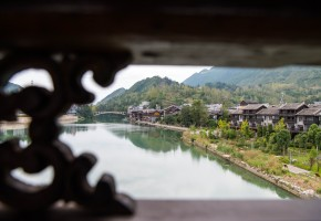 Tourists visit covered bridge in China