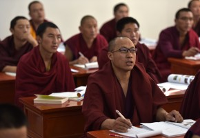 Monks have lesson at Qinghai Tibetan Buddhism college in China