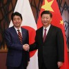 President Abe and Xi pledge Japan and China will deepen cooperation