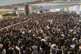Flight check-in suspended as Hong Kong airport swamped for second day