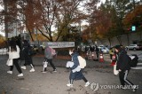 Cold spell sweeps South Korea on college exam day