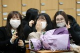 One month into outbreak, people in South Korea adjust to changes
