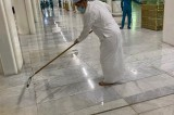 Modesty: Malaysian minister assists workers in sweeping rainwater