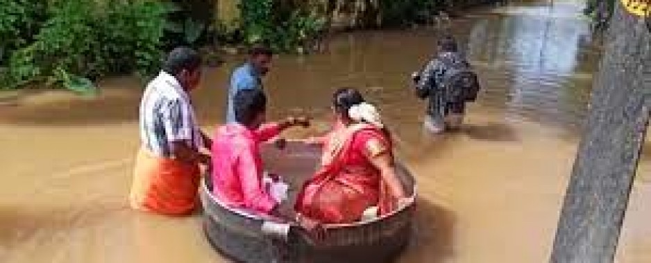 Love conquers all: Indian bride and groom float to wedding in cooking pot