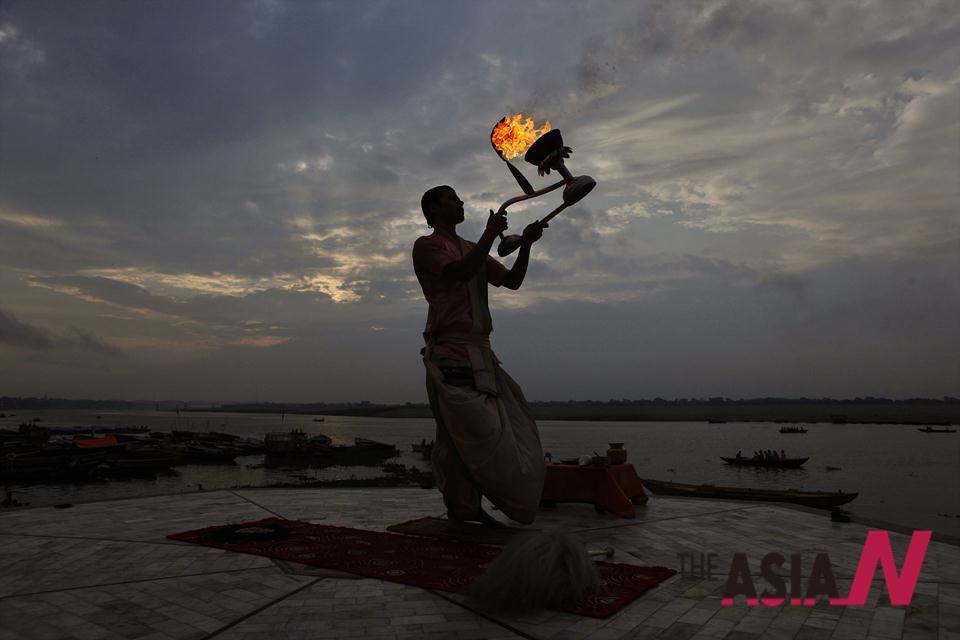 Hindu Priest's Morning Prayer In Varanasi   THEAsiaN