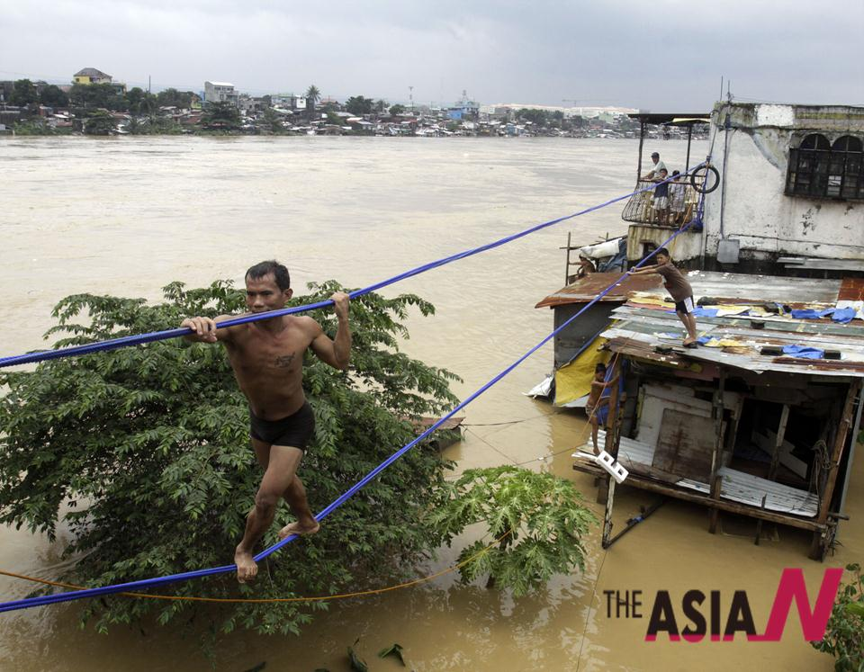 People Escape From Flooded Region Near Manila