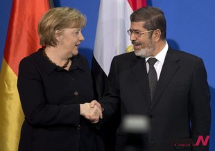 German Chancellor Merkel Shakes Hands With Egyptian President Morsi After Press Conference In Berlin