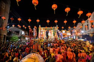 People dance in celebration of Chinese Lantern Festival in Malacca, Malaysia
