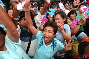 Supporters celebrate after Democrat Party candidate elected as Bangkok governor