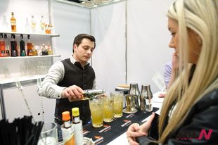 A Russian bartender makes cocktail during International Pub Festival