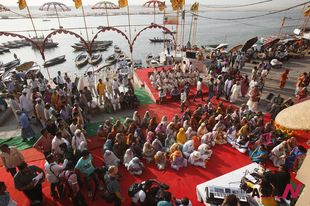 Elderly Indian widows pray on bank of Ganga river