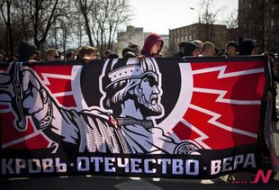 Russian nationalists carry old Empire flag while marching for May Day