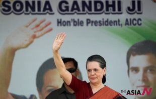 India's ruling Congress chief Sonia Gandhi waves to supporters