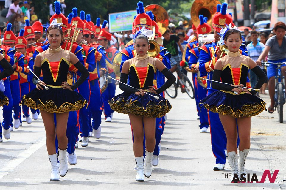 A filipino parade band marches during traditional Carabao Festival