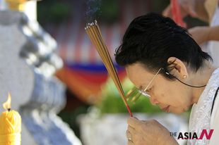 A Cambodian prays for 'Killing Field' victims at 'Day of Anger' events