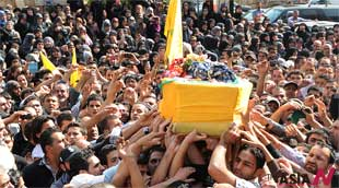Lebanese mourners carry Hezbollah fighter's coffin at funeral