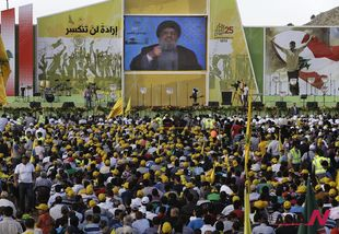 Hezbollah leader vows to support ally Syria while it is under attack