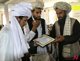 Afghan local Islamic school graduates receive graduation certificate
