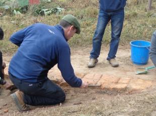 Prof. Dr. Robin Coningham of Durham University, UK, carefully removing soil that has covered the bricks of the walls of Shakya Palace in Tilaurakot. (Basant Giri)