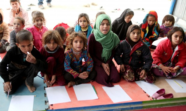 Children attend a class at a school at a refugee camp in Kabul, Afghanistan, Nov. 8, 2015. Nearly 3.5 million Afghan children, according to United Nations Children's Fund (UNICEF), are out of school, although the country has made tremendous achievements in the education field over the past 14 years. (Xinhua/Omid)