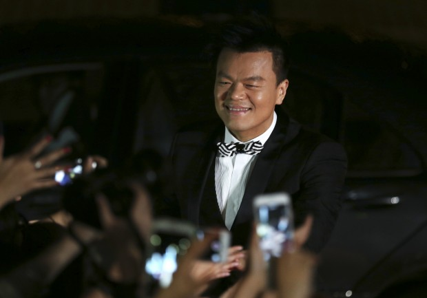 South Korean musician Park Jin-young walks on the red carpet of the 2015 Mnet Asian Music Awards (MAMA) in Hong Kong, Wednesday, Dec. 2, 2015. (AP Photo/Kin Cheung)