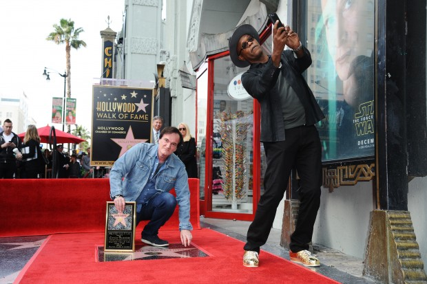 Quentin Tarantino, left, and Samuel L. Jackson attend a ceremony honoring Tarantino with a star on the Hollywood Walk of Fame on Monday, Dec. 21, 2015, in Los Angeles. (Photo by Richard Shotwell/Invision/AP)