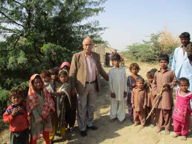 Author Nasir Aijaz, with children of Meghwar community in a village.