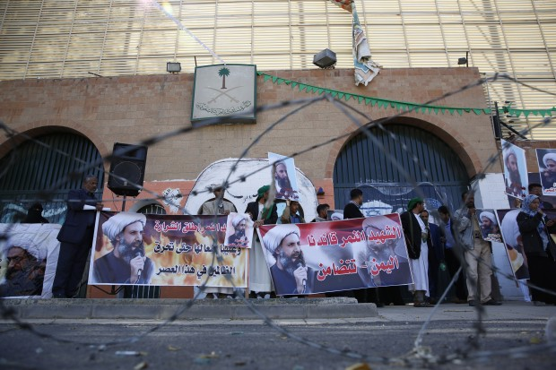 Shiite rebels, known as Houthis, hold posters of late Shiite cleric Nimr al-Nimr, who was executed in Saudi Arabia, during an anti-Saudi protest outside the Saudi embassy in Sanaa, Yemen, Thursday, Jan. 7, 2016. (AP Photo/Hani Mohammed)