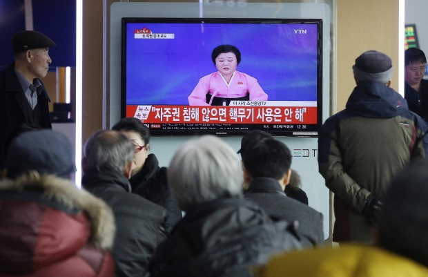 FILE - In this Wednesday, Jan. 6, 2016, file photo, people watch a TV news program showing North Korea's announcement, at the Seoul Railway Station in Seoul, South Korea. After ringing in the new year with claims of its first successful hydrogen bomb test, North Korea is now calling on the United States and the world community to accept it as a nuclear power, jettison the pursuit of punitive sanctions and allow it to focus on what it really wants: build up the nation's troubled economy. (AP Photo/Ahn Young-joon, File)