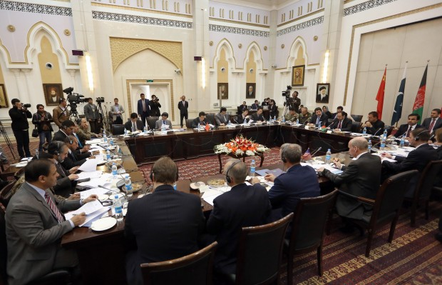 Delegations from Afghanistan, Pakistan, The United States of America and China discuss a road map for ending the war with the Taliban at the Presidential Palace in Kabul, Afghanistan, Monday, Jan. 18, 2016. Representatives of four countries met in the Afghan capital Kabul on Monday for a second round of talks aimed at bringing an end to Afghanistan's war by charting a roadmap to peace, a Foreign Ministry official said. (AP Photo/Rahmat Gul)