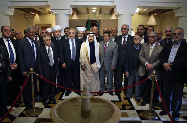 Saudi Ambassador to Lebanon Ali Awad Assiri, center, poses for a photograph with Lebanese politicians during their visit to express their solidarity with the Kingdom of Saudi Arabia, at the Saudi Embassy in Beirut, Lebanon, Wednesday, Feb. 24, 2016. (AP Photo/Bilal Hussein)