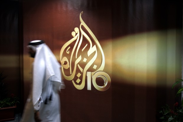 Al-Jazeera, the Qatar-based broadcaster, said Sunday, March 27, 2016 it is slashing about 500 jobs worldwide little more than two months after shutting its U.S. offshoot. (AP Photo/Kamran Jebreili, File)