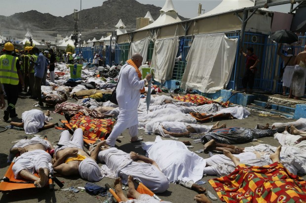 "FILE - In this Sept. 24, 2015, file photo, a Muslim pilgrim walks through the site where dead bodies are gathered after a stampede during the annual hajj pilgrimage, in Mina, Saudi Arabia. The Saudi Gazette reported the kingdom has held a workshop to review hajj security plans following a deadly crush that killed more than 2,400 pilgrims last year. The newspaper reported that the three-day workshop, which ends Thursday, March 24, 2016, reviewed emergency medical plans and ""the lessons of last year's hajj season.""  (AP Photo, File)"