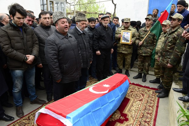 (160403) -- BAKU, April 3, 2016 (Xinhua) -- People attend the funeral of a villager who was killed in recent conflict with Armenia, in Azerbaijan's Terter district bordering the disputed Nagorno-Karabakh region, on April 3, 2016. Azerbaijan unilaterally suspended all military operations and response measures in the high-strung disputed Nagorno-Karabakh region with Armenia, the Azerbaijani Defense Ministry said on Sunday. (Xinhua/Tofik Babayev)