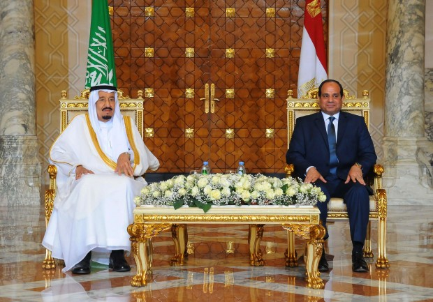Egyptian President Abdel-Fattah el-Sissi, right, sits with Saudi Arabia's King Salman in Cairo.  Egypt welcomed Saudi Arabia's monarch on a landmark visit to the Arab world's most populous country on Thursday, with Cairo seeking to boost ties and garner deals to prop up the nation's shaky economy despite some persistent divisions with the Sunni powerhouse. (Fady Faris, Egyptian Presidency via AP)