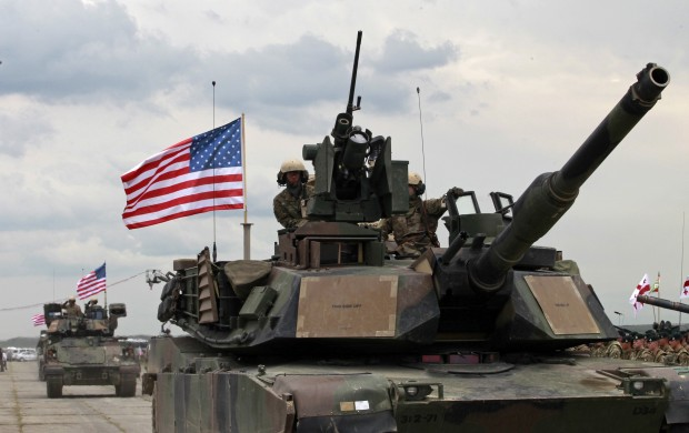 U.S servicemen drive their armored vehicles at the opening ceremony of U.S, British and Georgian troops joint military exercises at the Vaziani military base outside Tbilisi, Georgia, Wednesday, May 11, 2016. About 1,300 U.S., British and Georgian troops are conducting joint exercises aimed at training the former Soviet republic's military for participation in the NATO Response Force. (AP Photo/Shakh Aivazov)