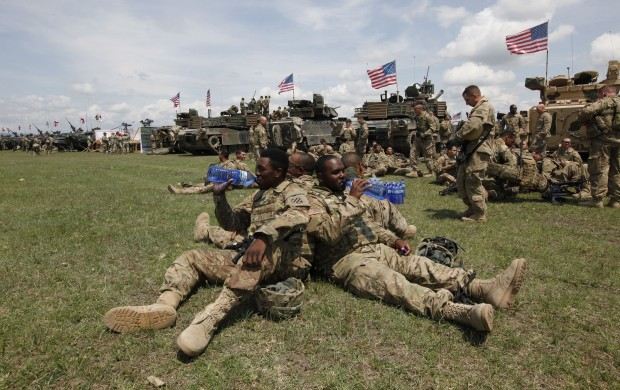 U.S. servicemen wait for the opening ceremony of U.S, British and Georgian troops joint military exercises at the Vaziani military base outside Tbilisi, Georgia, Wednesday, May 11, 2016. About 1,300 U.S., British and Georgian troops are conducting joint exercises aimed at training the former Soviet republic's military for participation in the NATO Response Force. (AP Photo/Shakh Aivazov)