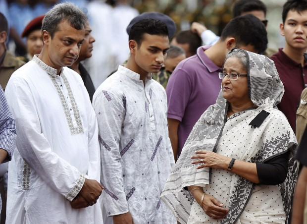 Bangladeshi Prime Minister, Sheikh Hasina, talks to the relatives of Bangladeshi victims of the attack on Holey Artisan Bakery during a memorial service in Dhaka, Bangladesh, Monday, July 4, 2016. The brutality of the attack, the worst convulsion of violence yet in the recent series of deadly attacks to hit Bangladesh, has stunned the traditionally moderate Muslim nation and raised global concerns about whether it can cope with the increasingly strident Islamist militants. (AP Photo)
