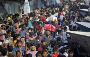 Bangladeshi Muslims crowd a ferry terminal as they prepare to travel to their hometowns for Eid al-Adha festival in Dhaka, Bangladesh, Friday, Sept. 9, 2016. Muslims around the world celebrate Eid al-Adha, or the Feast of the Sacrifice, to commemorate the prophet Ibrahim's faith in being willing to sacrifice his son. (AP Photo/A.M. Ahad)