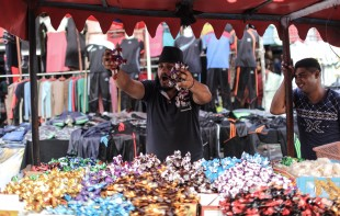 (160912) -- GAZA, Sept. 12, 2016 (Xinhua) -- A Palestinian vendor sells sweets in a market ahead of the Muslim festival Eid al-Adha in Gaza City, Sept. 11, 2016. Muslims across the world are preparing to celebrate the annual festival of Eid al-Adha, or the Festival of Sacrifice. (Xinhua/Wissam Nassar) (zjy)
