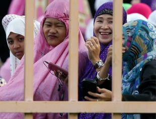 Filipino Muslims gather at the Blue Mosque to mark Eid al-Adha (Feast of the Sacrifice) Monday, Sept. 12, 2016 in suburban Taguig city, east of Manila, Philippines. Muslims around the world celebrate Eid al-Adha by sacrificing animals to commemorate the prophet Ibrahim's faith in being willing to sacrifice his son. (AP Photo/Bullit Marquez)