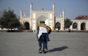An Afghan man walks in Eid Gah mosque before offering Eid al-Adha prayers in Kabul, Afghanistan, Monday, Sept. 12, 2016. Muslims around the world will celebrate Eid al-Adha, the Festival of Sacrifice, to mark the end of the hajj pilgrimage by slaughtering sheep, goats, cows and camels to commemorate Prophet Abraham's readiness to sacrifice his son Ismail on God's command. (AP Photo/Massoud Hossaini)
