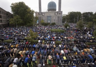 Russian Muslims pray outside a mosque in St. Petersburg, Russia, as they celebrate Eid al- Adha, which Muslims in Russia call Kurban-Bairam, on Monday, Sept. 12, 2016. (AP Photo/Dmitri Lovetsky)