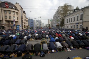 Muslims pray outside a mosque during celebrations of Eid al-Adha, a feast celebrated by Muslims worldwide, which Muslims in Russia call Kurban-Bairamin Moscow, Russia, on Monday, Sept. 12, 2016. (AP Photo/Ivan Sekretarev)