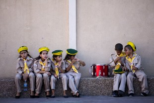 Israeli Arab youths, from the scouts youth movement, prepare for a parade for the Eid al-Adha festival in the mixed Arab Jewish neighborhood of Jaffa, near Tel Aviv, Israel, Monday, Sept. 12, 2016. Muslims around the world will celebrate Eid al-Adha, the Festival of Sacrifice, to mark the end of the hajj pilgrimage by slaughtering sheep, goats, cows and camels to commemorate Prophet Abraham's readiness to sacrifice his son Ismail on God's command. (AP Photo/Oded Balilty)